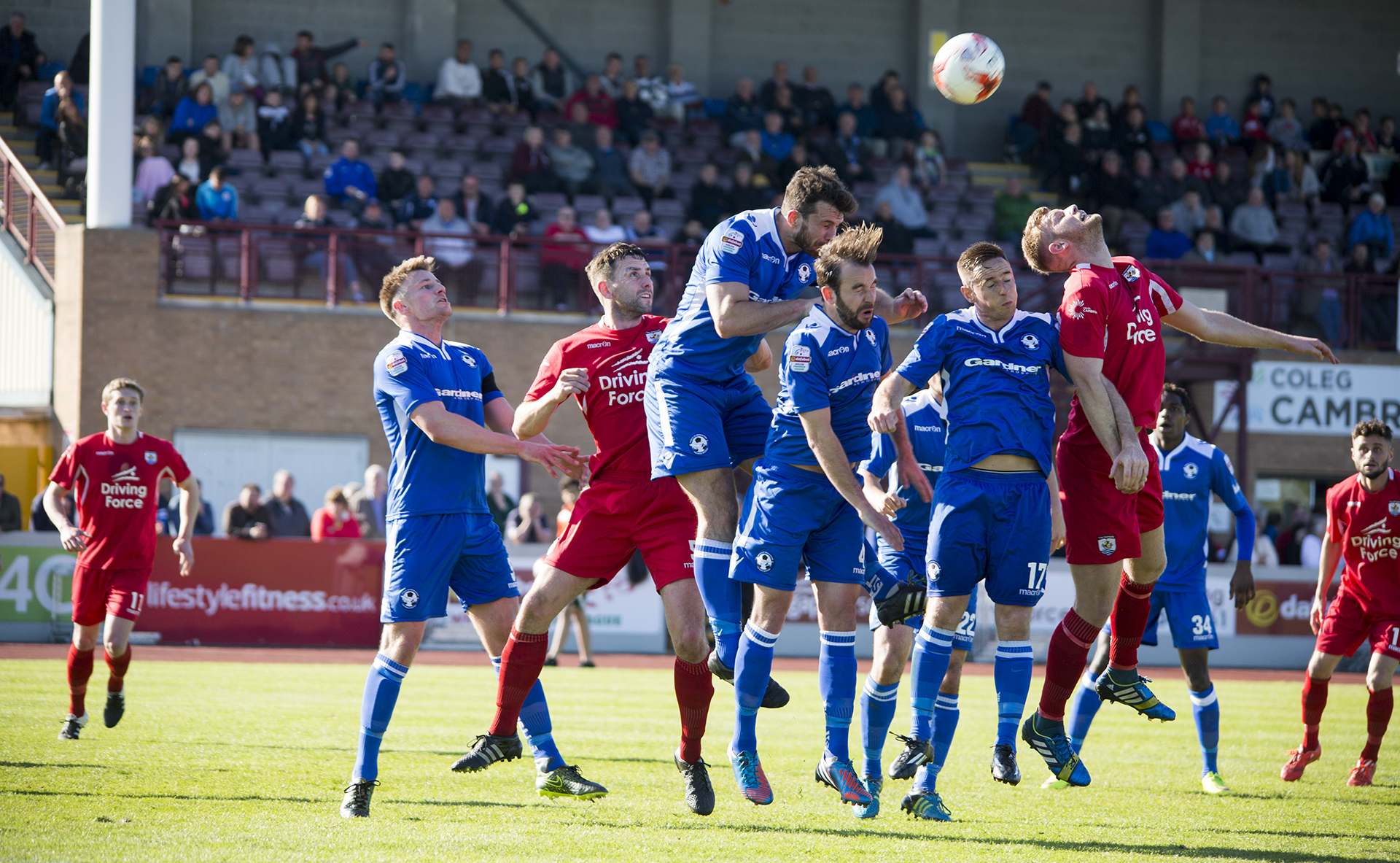 The Nomads' Jay Crowther challenges for the ball in front of a record Deeside Stadium crowd
