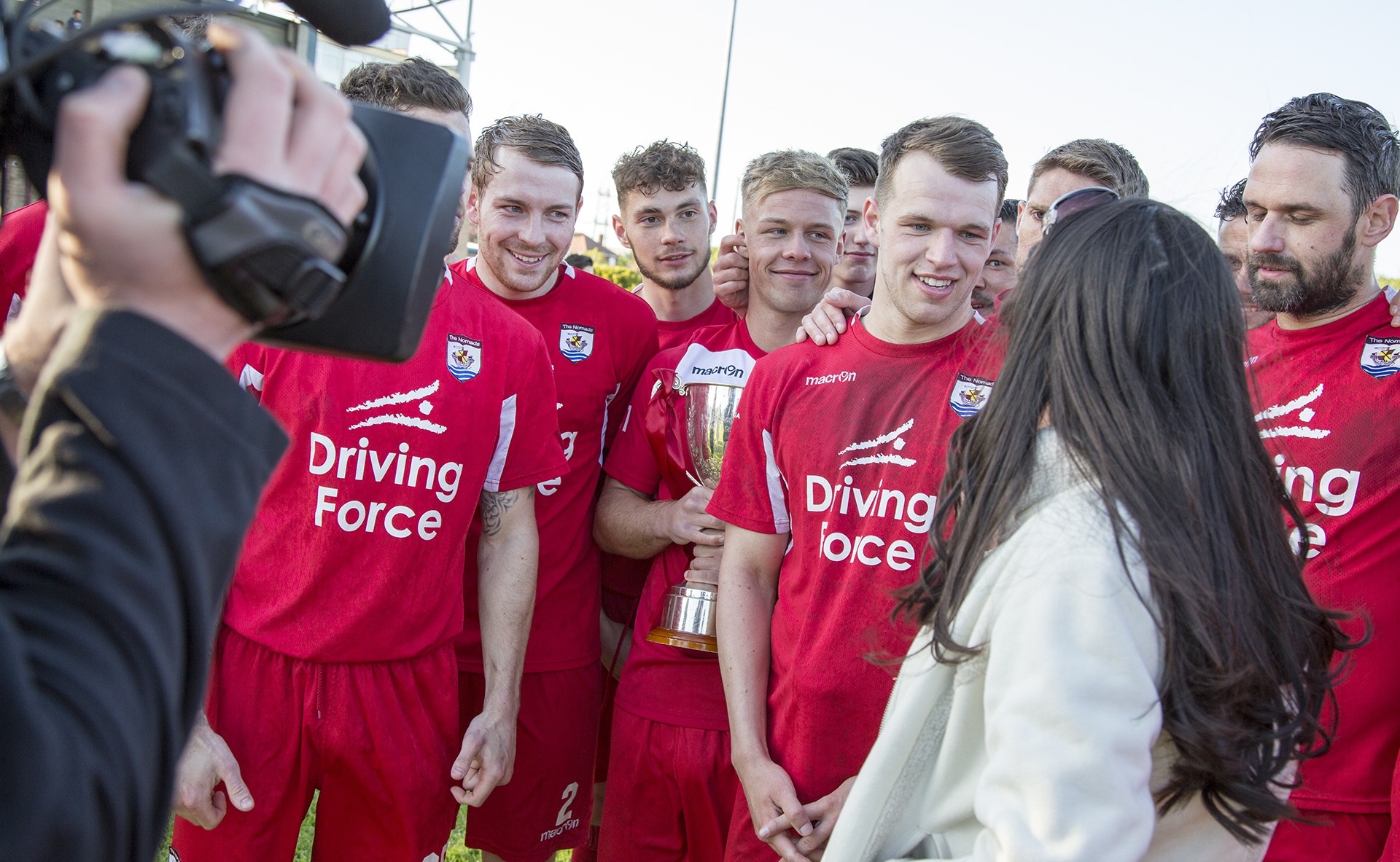 Callum Morris is interviewed alongside his teammates by S4C's Gwennan Harries following The Nomads' 1-0 victory over Airbus UK