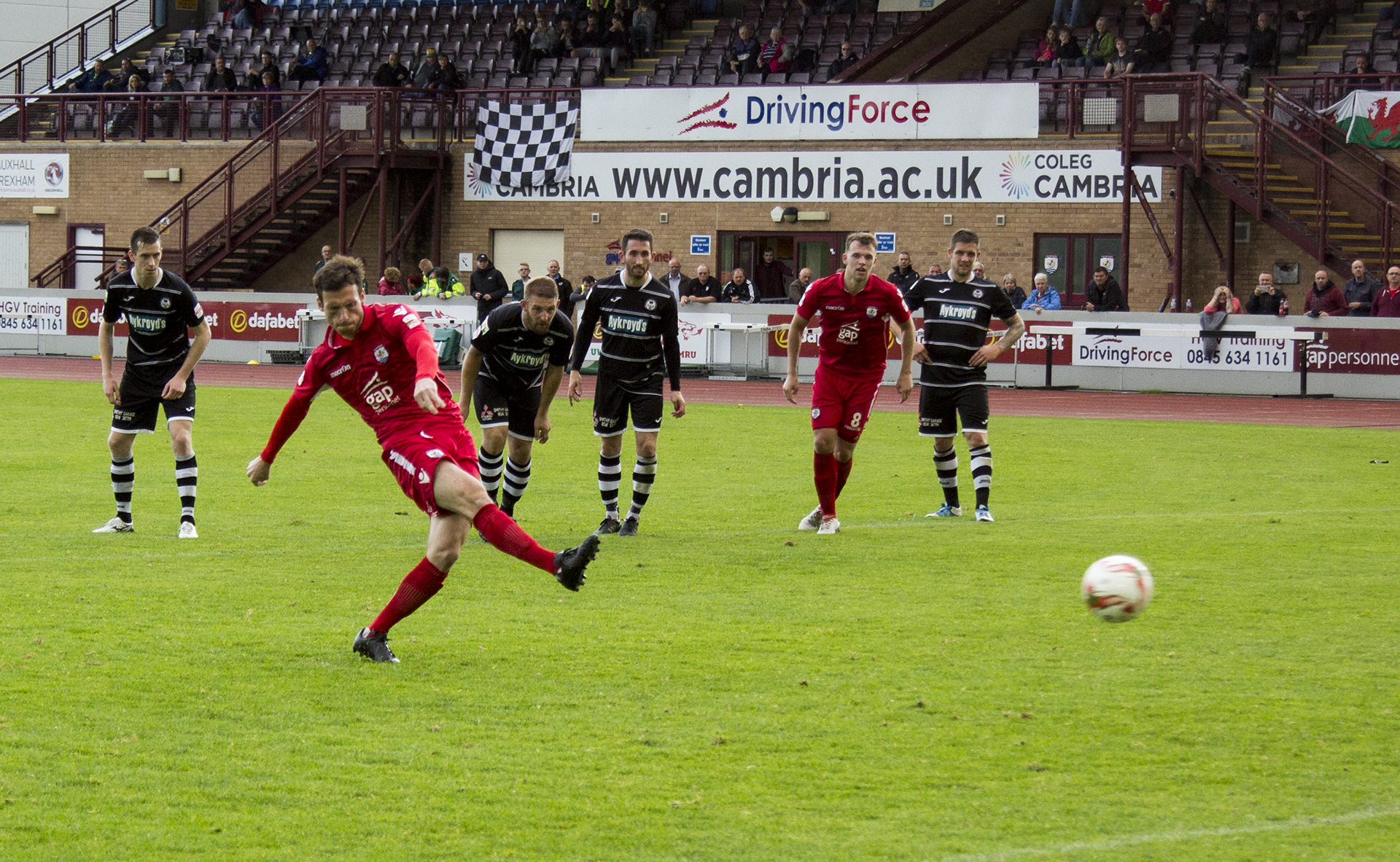Matty Williams levels from the penalty spot for The Nomads