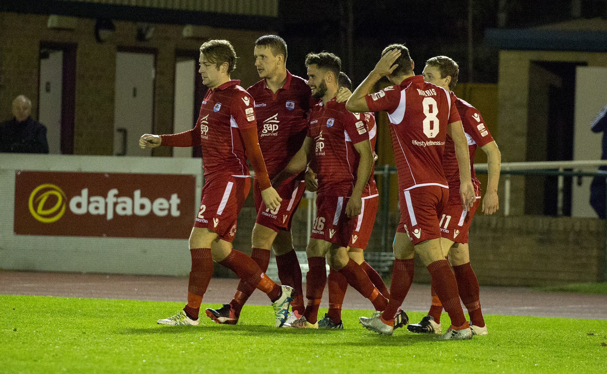 The Nomads celebrate Nathan Woolfe's opening goal - © NCM Media