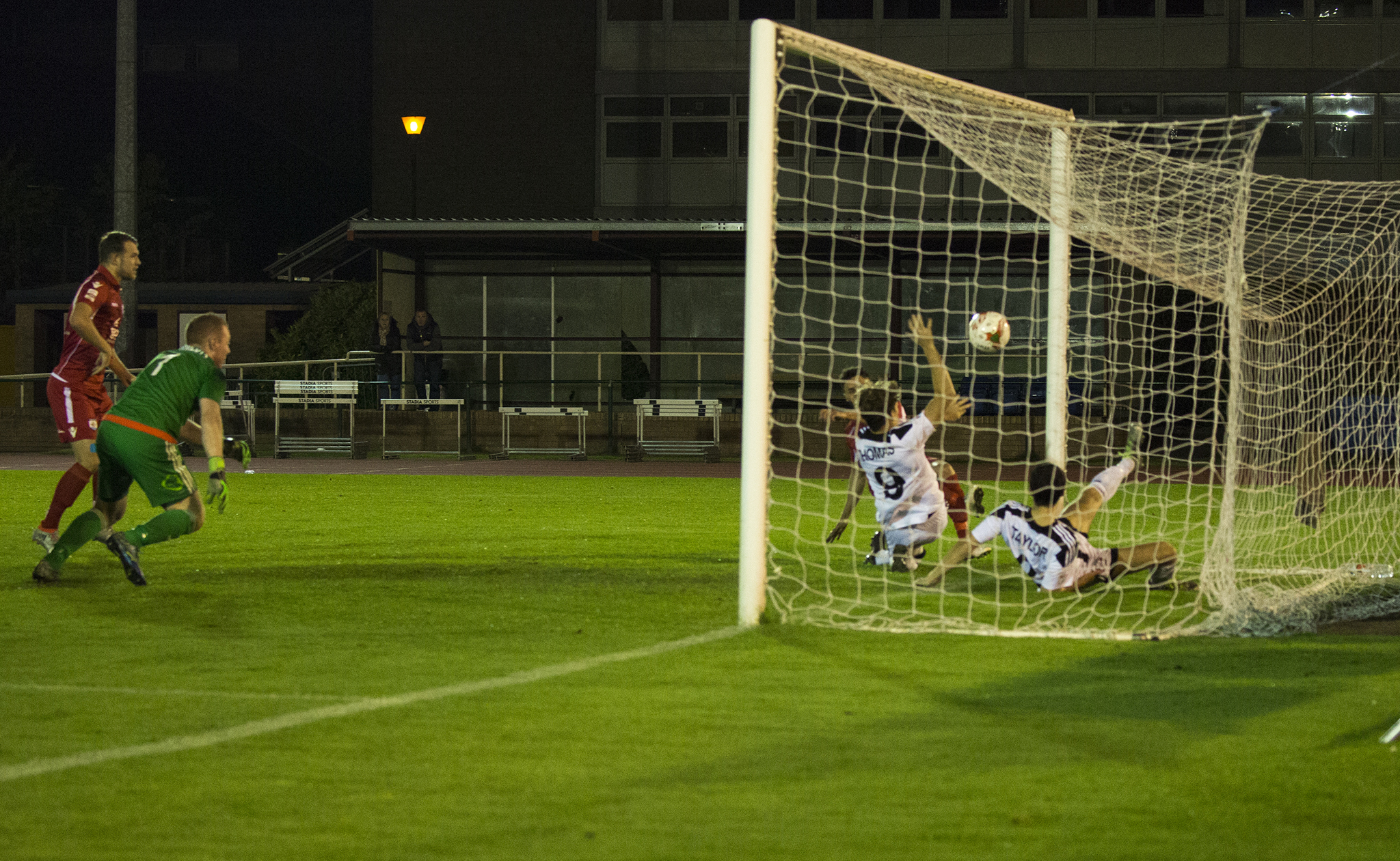 Nathan Woolfe scores from close range for The Nomads - © NCM Media
