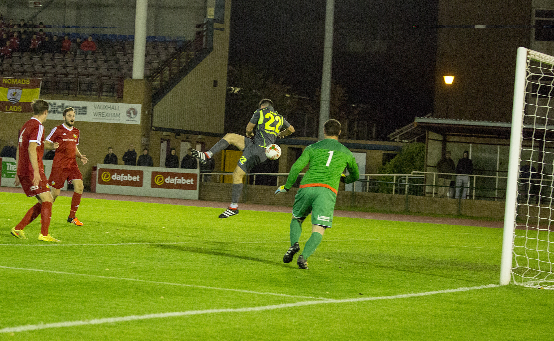 Michael Wilde cleverly scores The Nomads' third of the game - © NCM Media