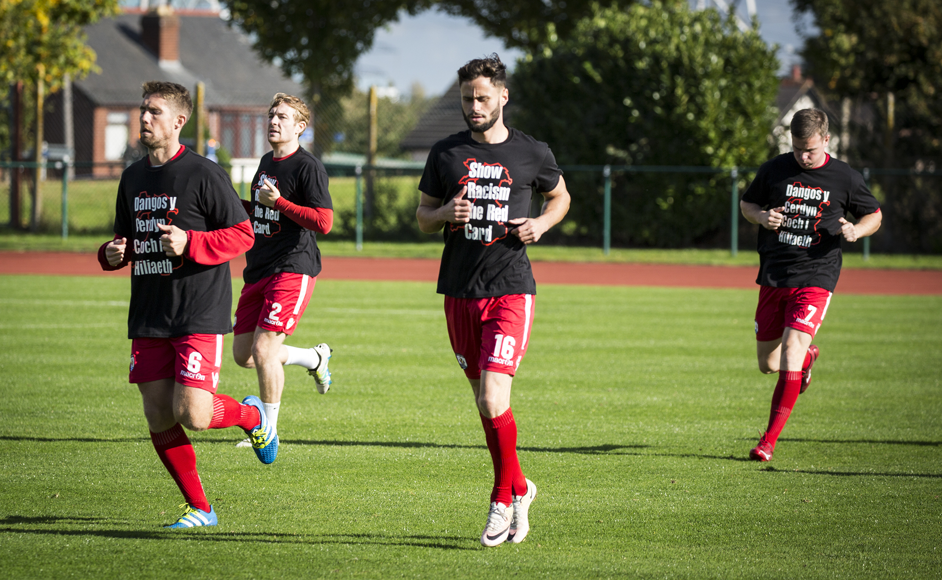 The Nomads warmed up ahead of kick off in their Show Racism the Red Card t-shirts - © NCM Media