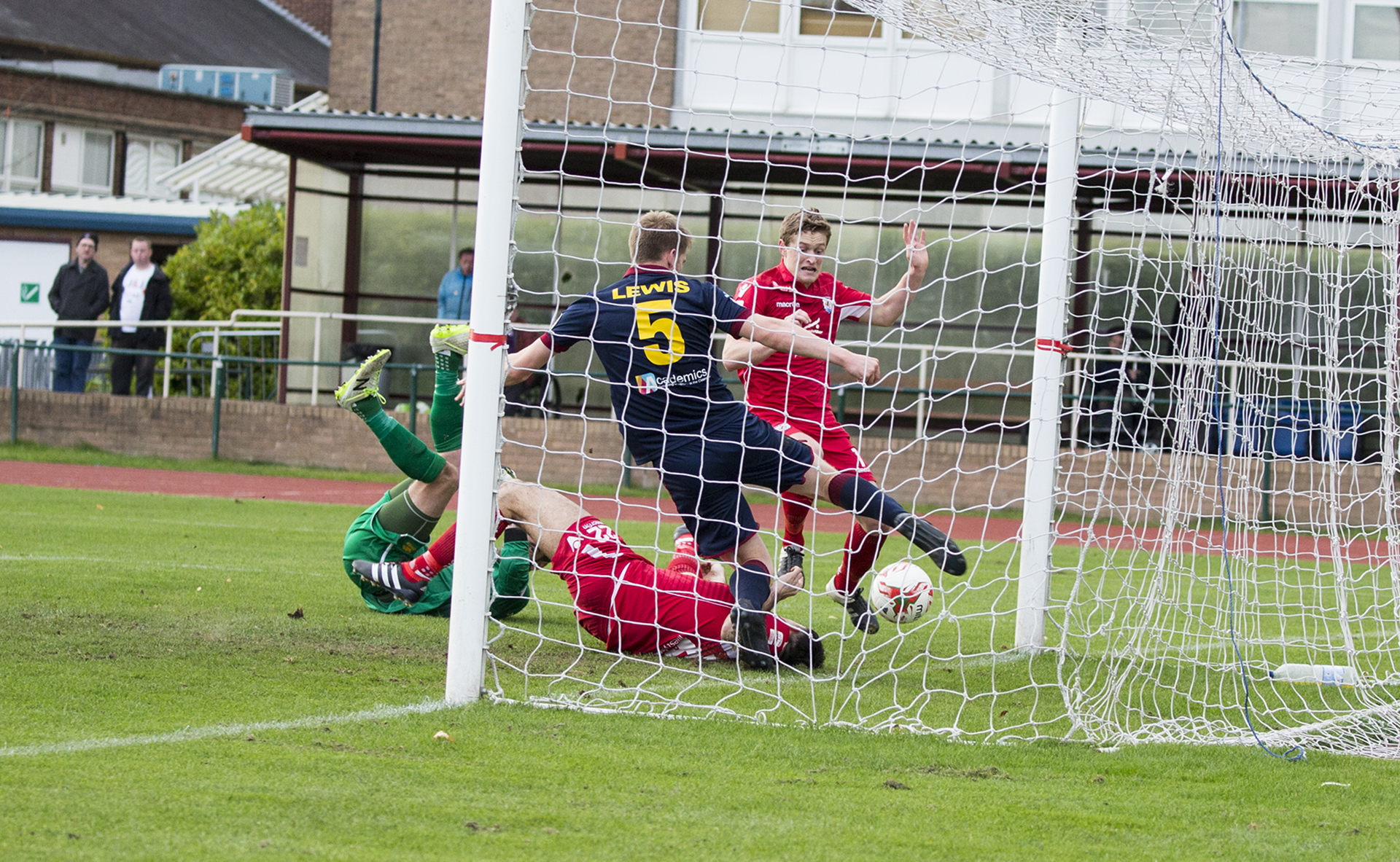 Emlyn Lewis clears off the line for Cardiff Met - © NCM Media