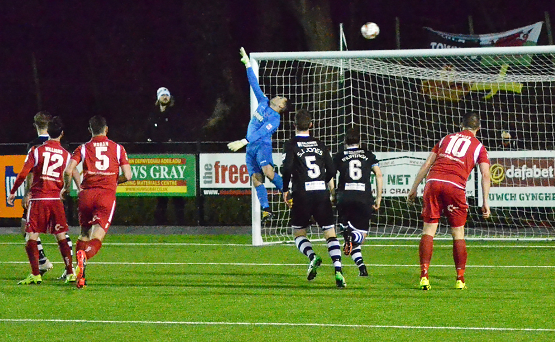 The ball sails just over Ashley Morris in the Bala Town goal - Photo courtesy of Bala Town FC