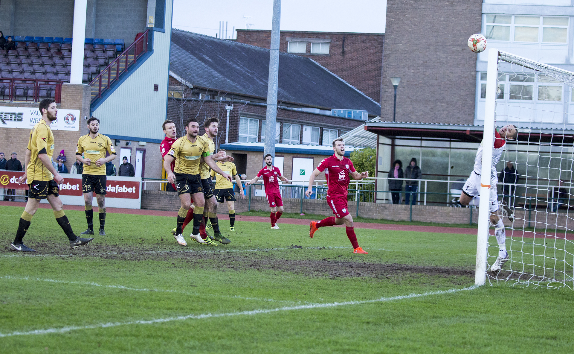Les Davies sees his effort sail just over Lee Idzi's crossbar - © NCM Media