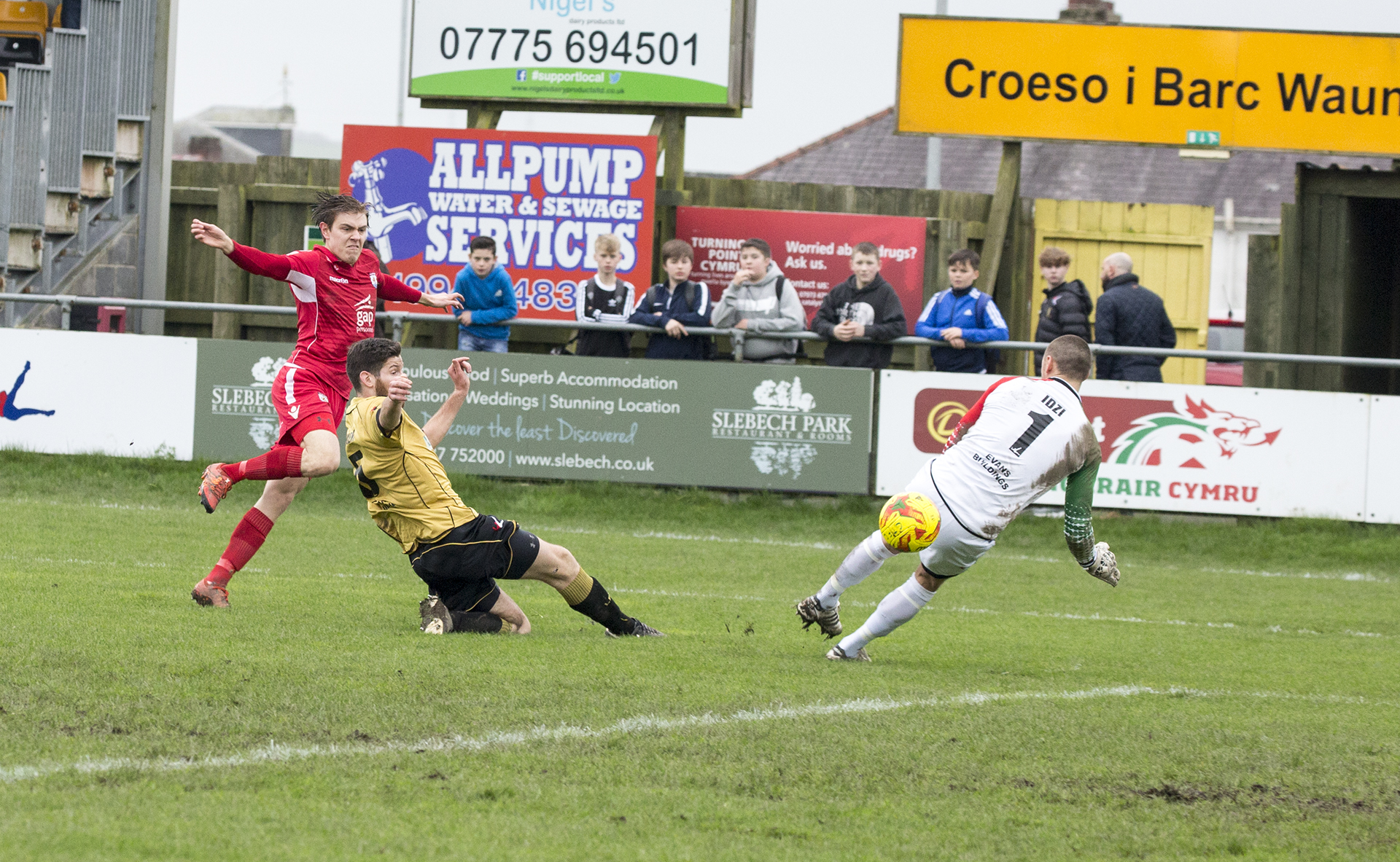 Lewis Short scores The Nomads' third against Carmarthen Town - © NCM Media