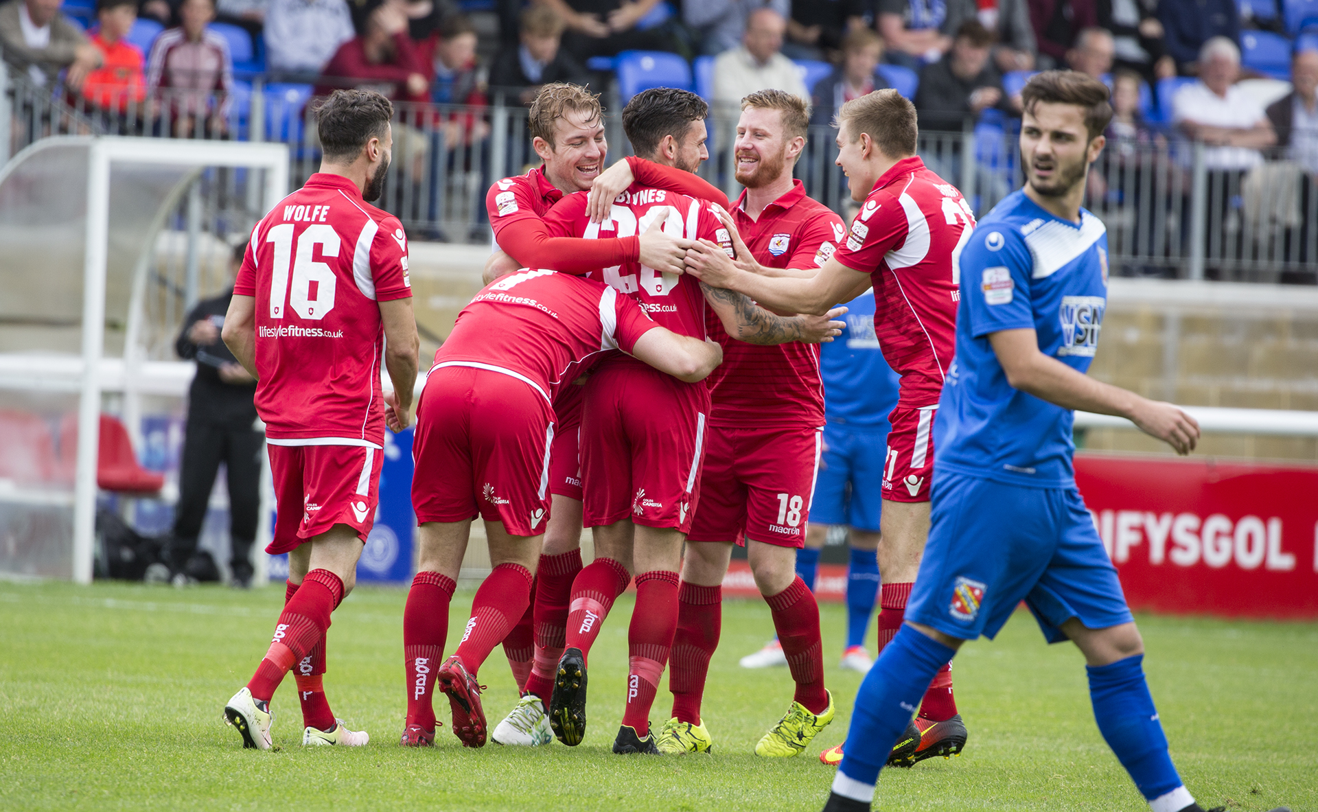 The Nomads' celebrate Wes Baynes' strike at Bangor City - © NCM Media