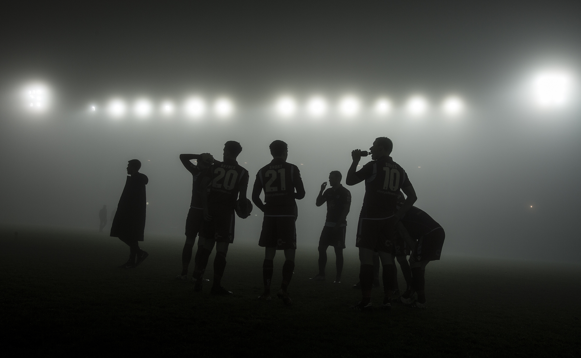Nik's photo of The Nomads' players waiting on the referee's decision during the Nathaniel MG Cup game against TNS, which was eventually called off due to fog has been shortlisted.