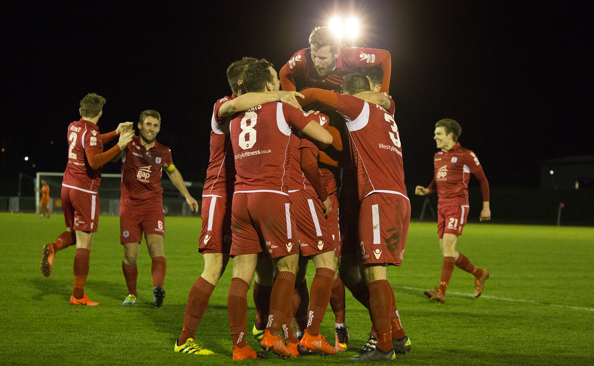 The Nomads celebrate Declan Poole's wonderstrike against TNS - © NCM Media