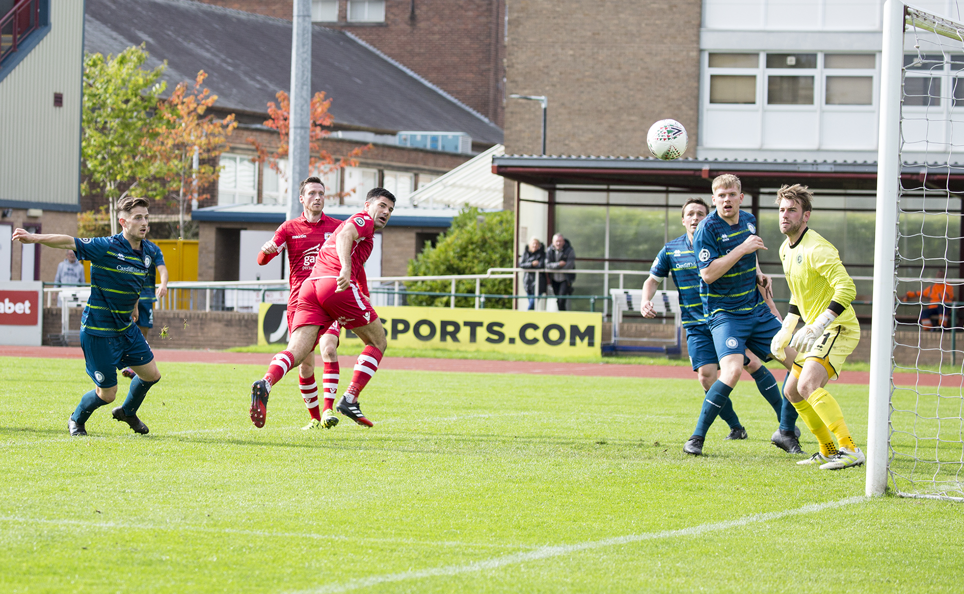 Michael Wilde watches on as his first half header strikes the post - © NCM Media