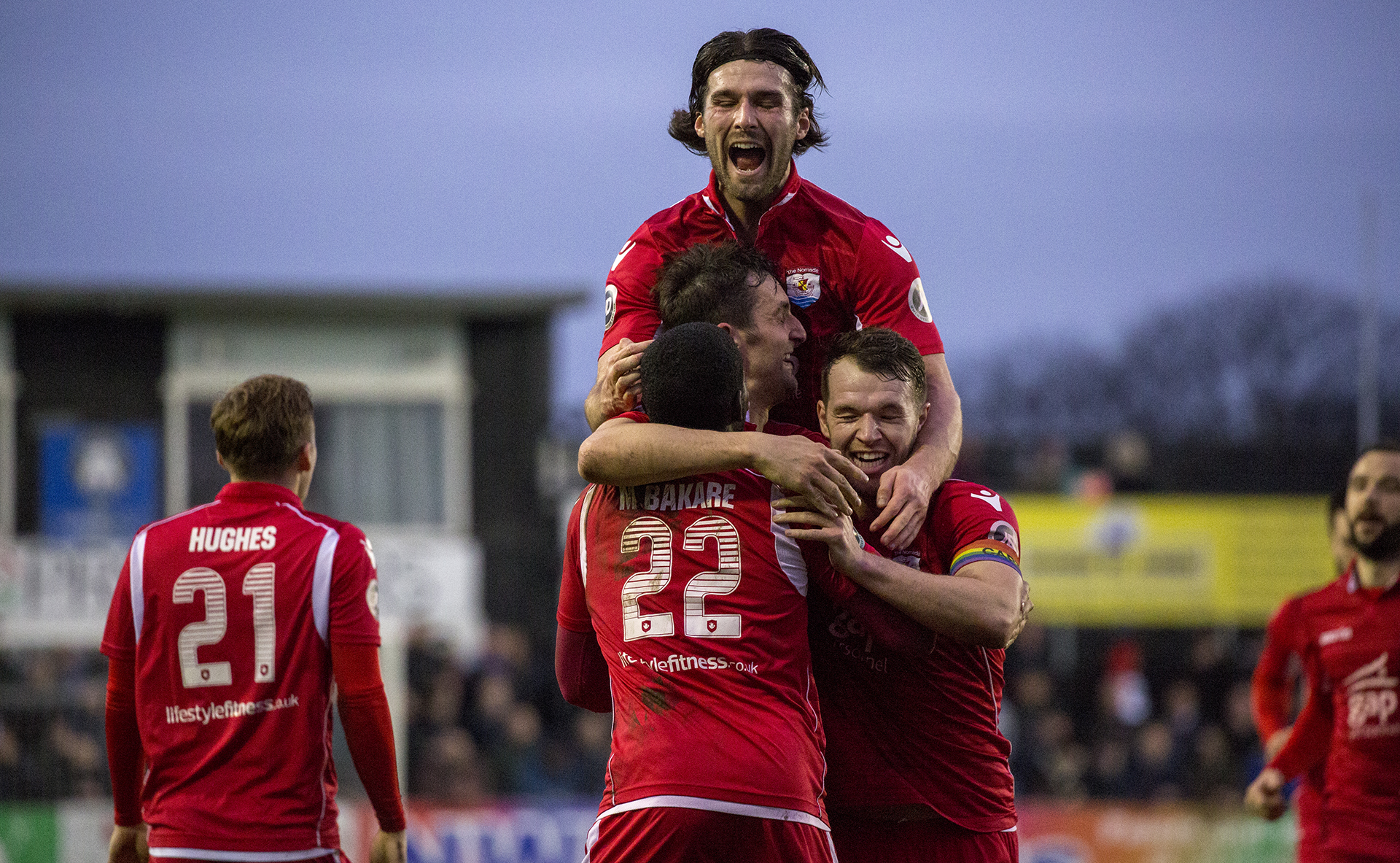 The Nomads celebrate Andy Owens' opening goal - © NCM Media