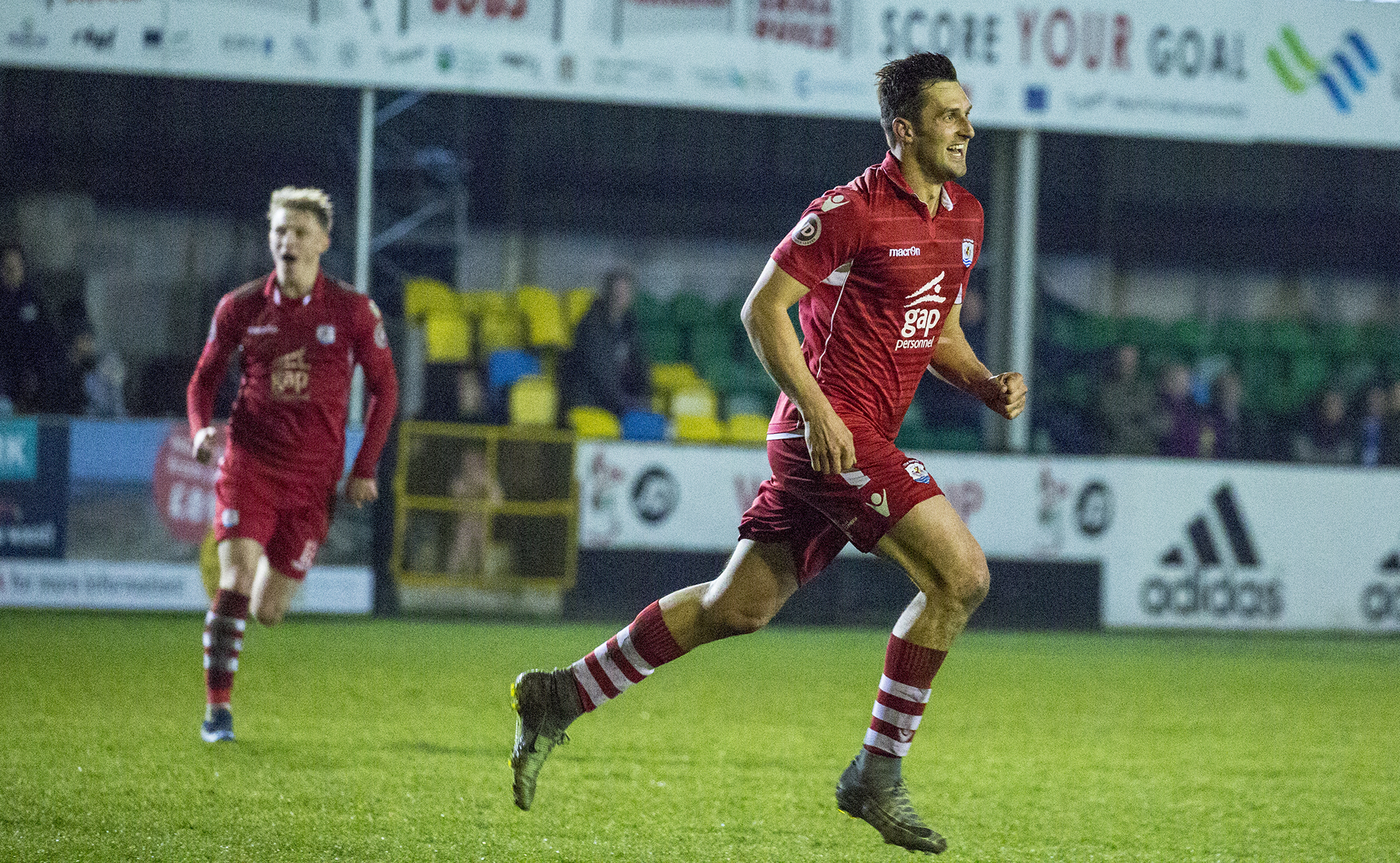 Andy Owens celebrates his second strike against Bangor City - © NCM Media