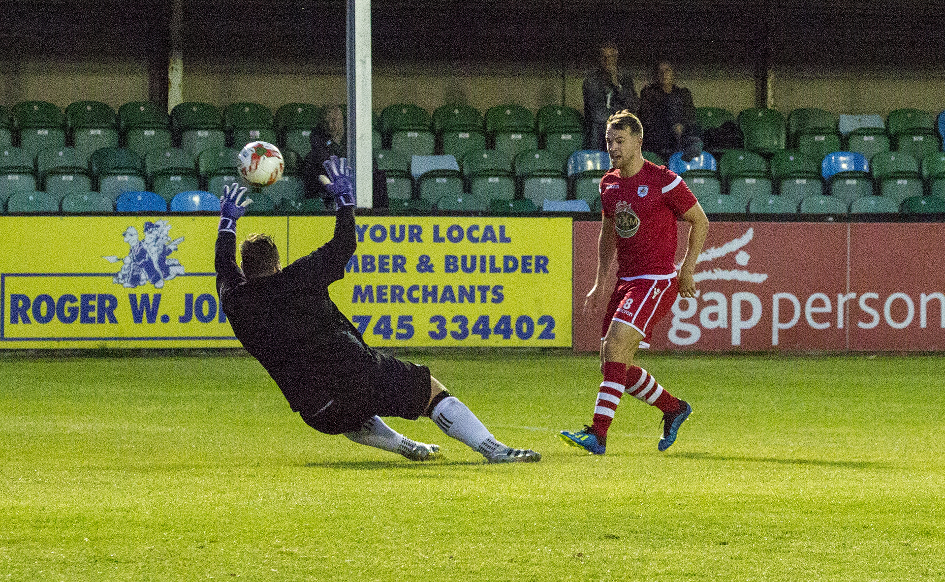 Callum Morris lifts the ball over Jon Hill-Dunt to give The Nomads the lead © NCM Media