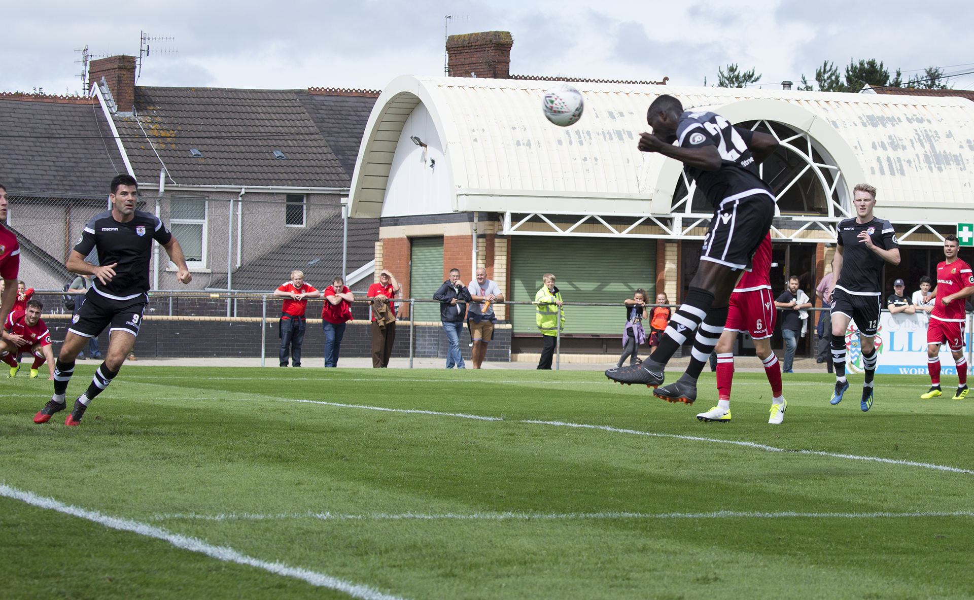 Michael Bakare rises to score the first of his brace on the day © NCM Media