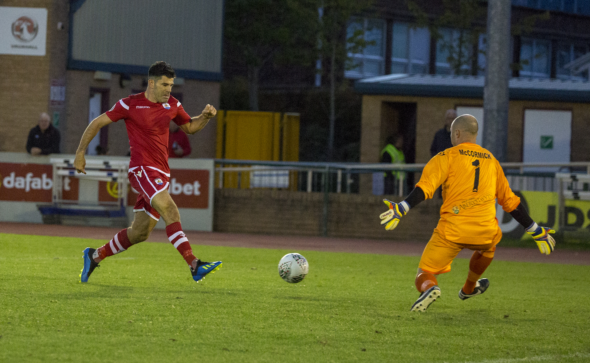 Michael Wilde slots beyond Terry McCormick for The Nomads' second goal of the night © NCM Media