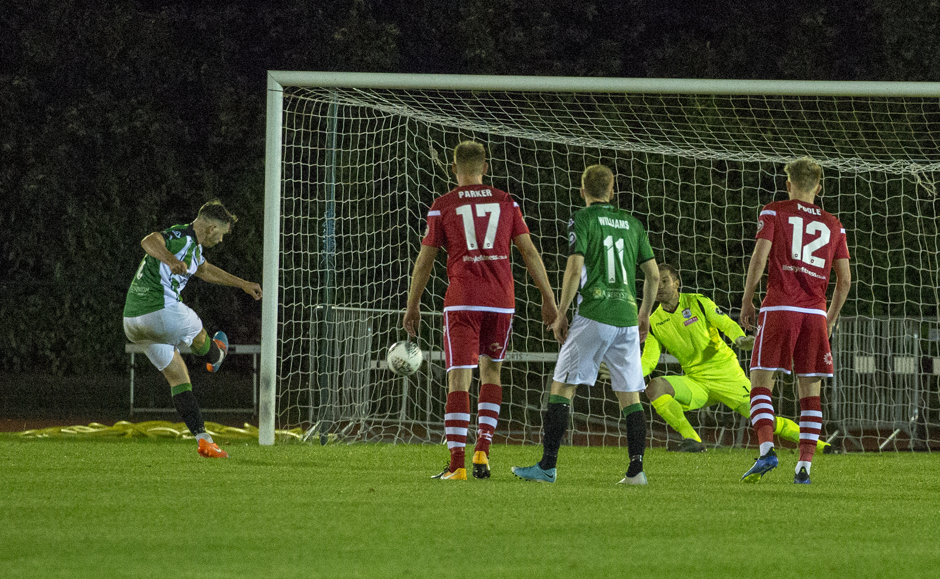 John Danby dives to save Declan Walker's penalty late in the second half © NCM Media