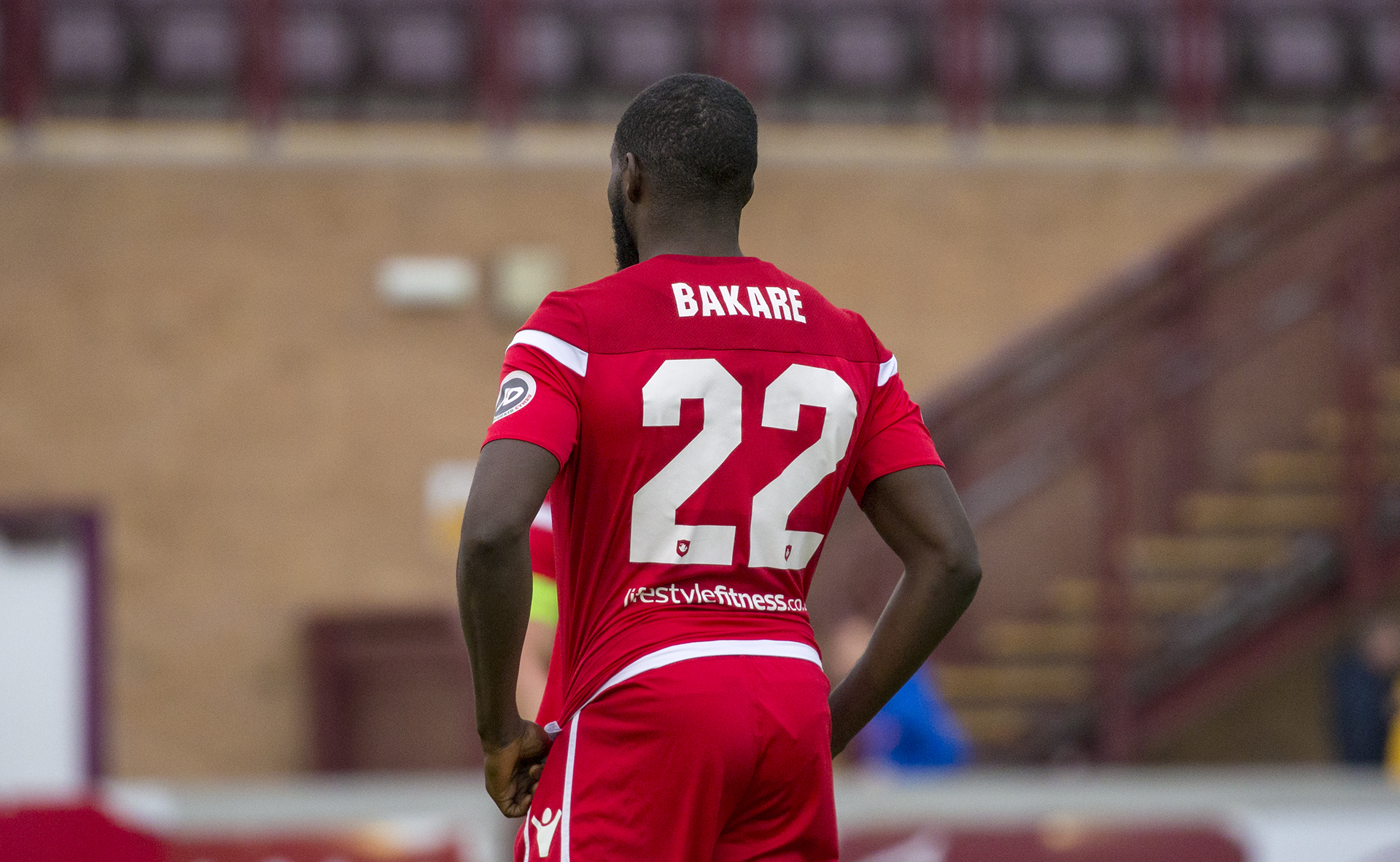 Michael Bakare has signed a new deal at Connah's Quay Nomads until 2020