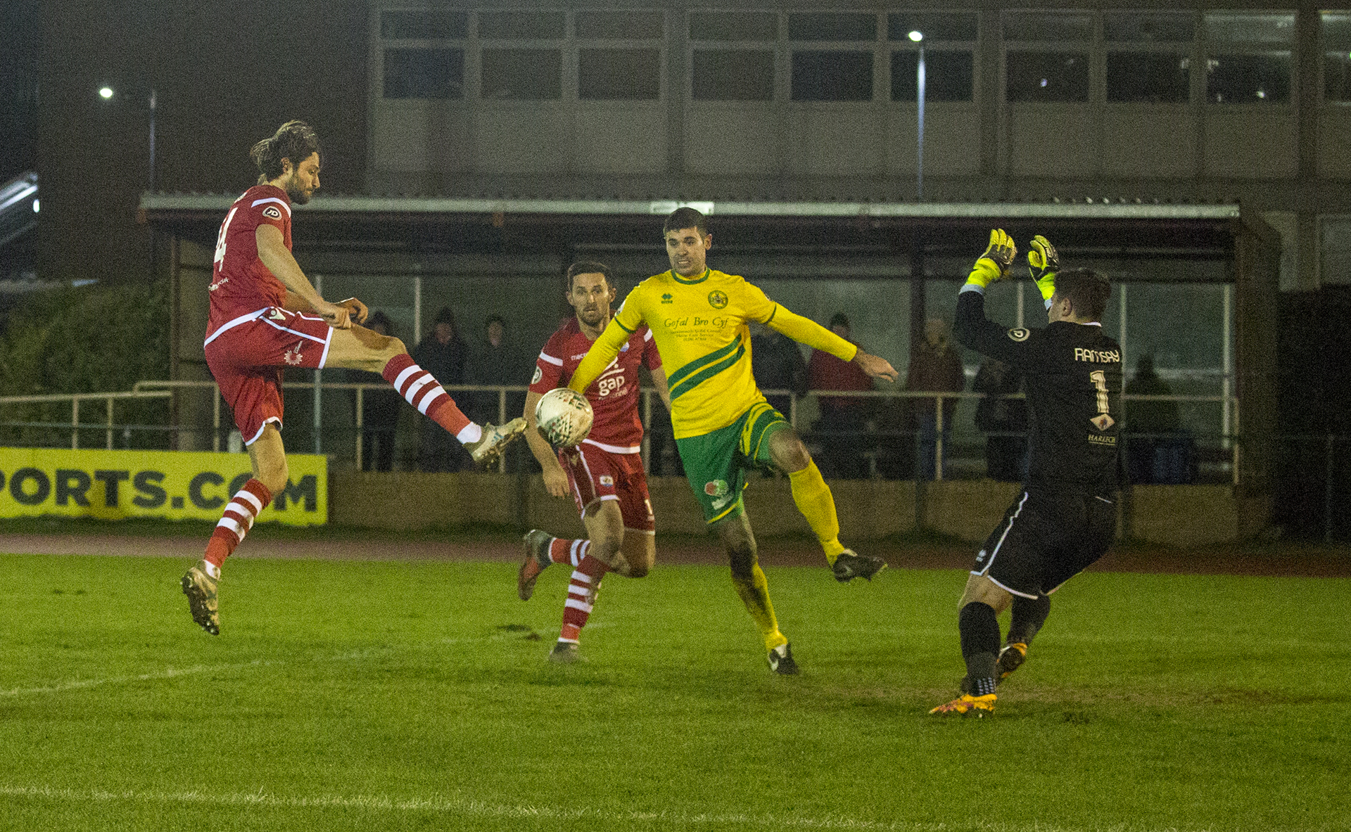 Adam Barton beats the Caernarfon defence to the ball to get on the scoresheet | © NCM Media