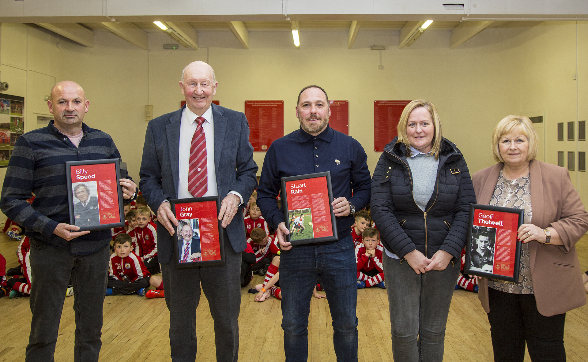 David Speed, John Gray, Stuart Rain and Geoff Thelwell's two daughters accepting their respective inductions in to the Connah's Quay Nomads Hall of Fame | © NCM Media