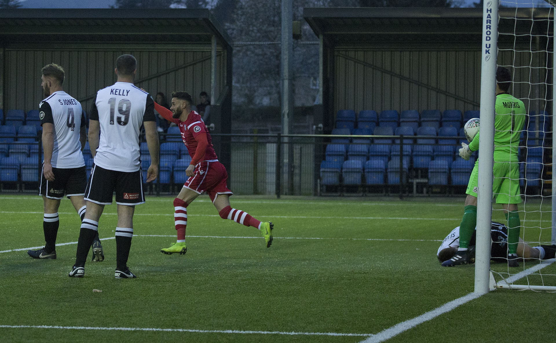 Nathan Woolfe wheels away celebrating his first goal | © NCM Media