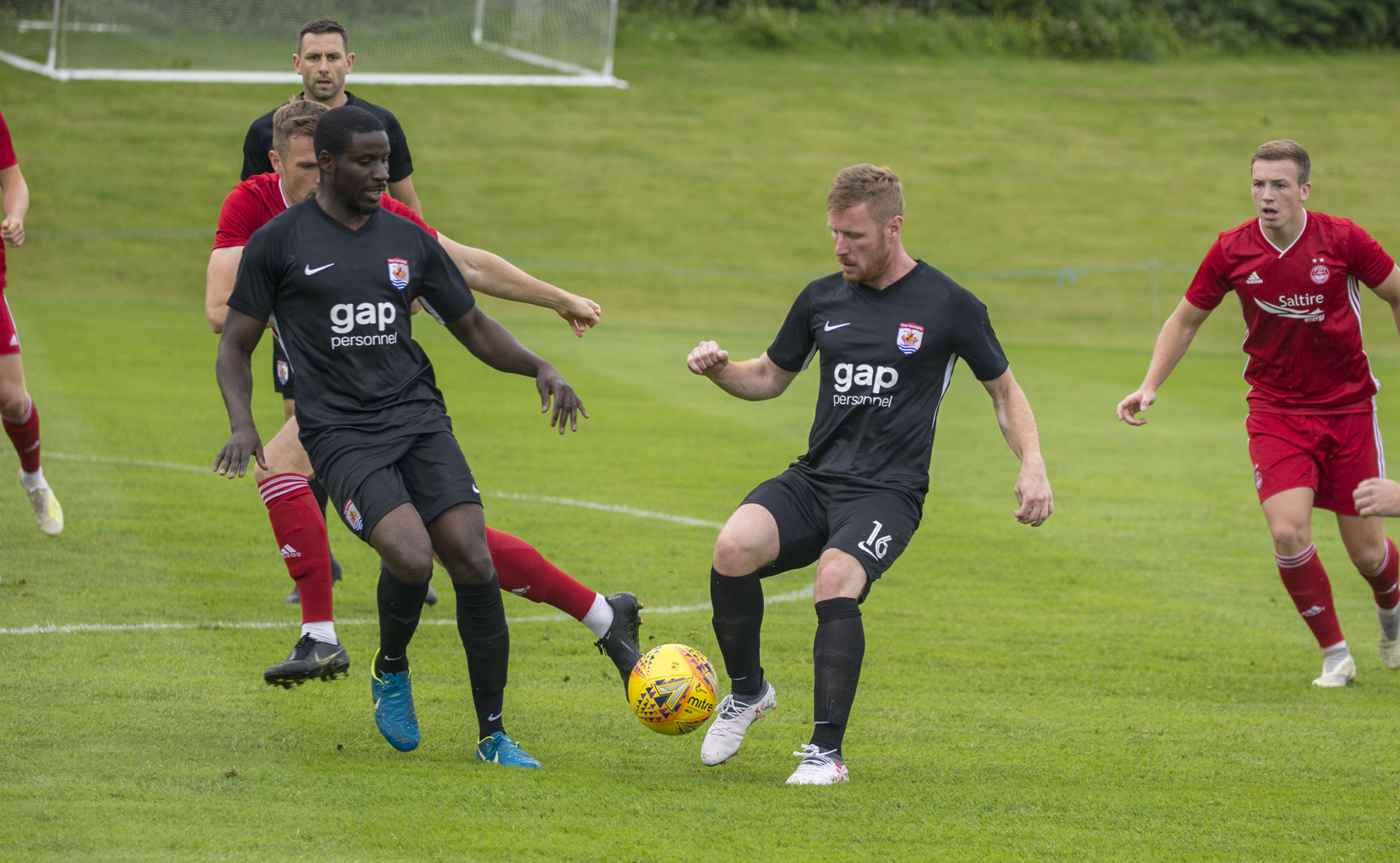 Michael Bakare (left) and Jay Owen (right) look to keep possession during a first half attack | © NCM Media