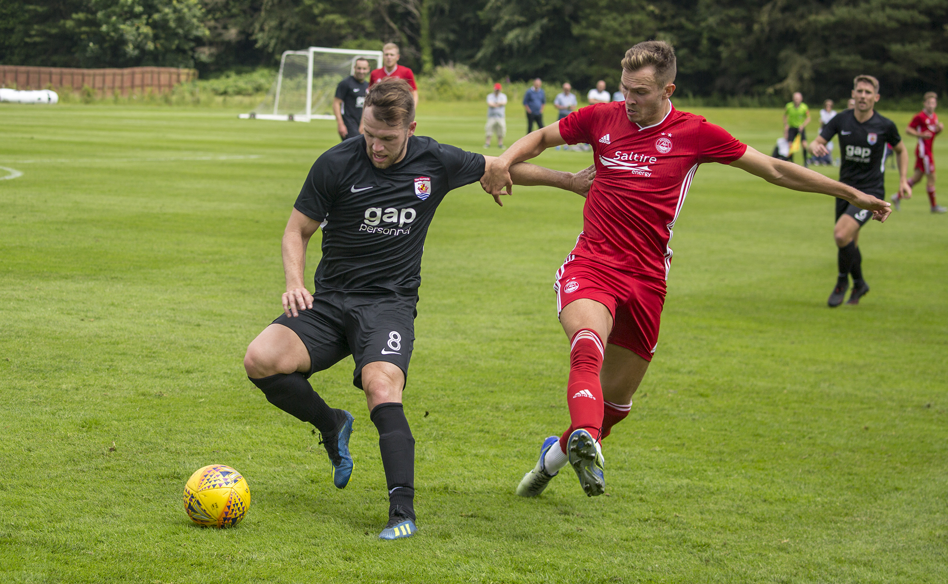 Callum Morris (left) battles with ex Flint Town United player, Ryan Hedges | © NCM Media
