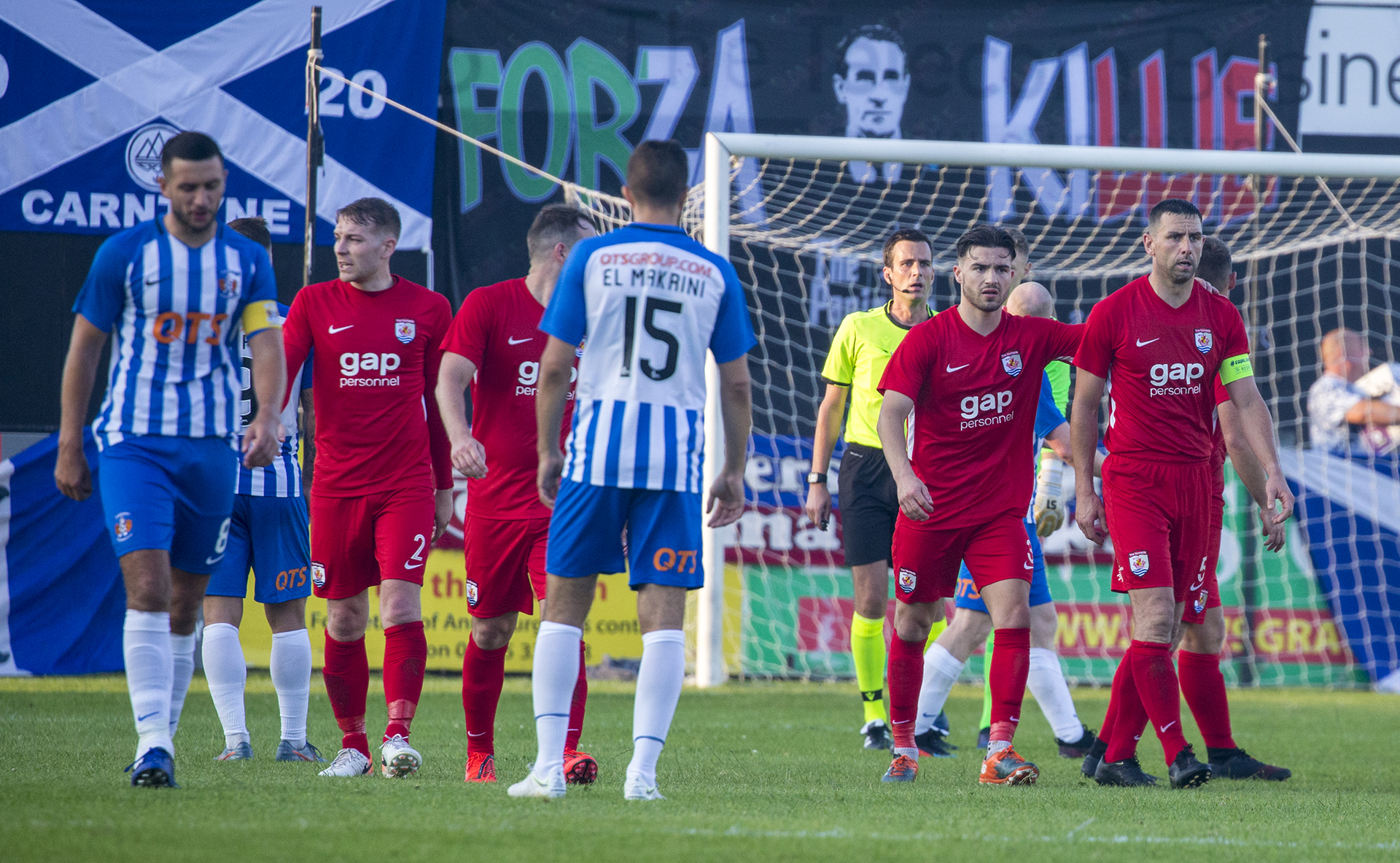 Disappointed Nomads players look on as Kilmarnock celebrate their equaliser | © NCM Media