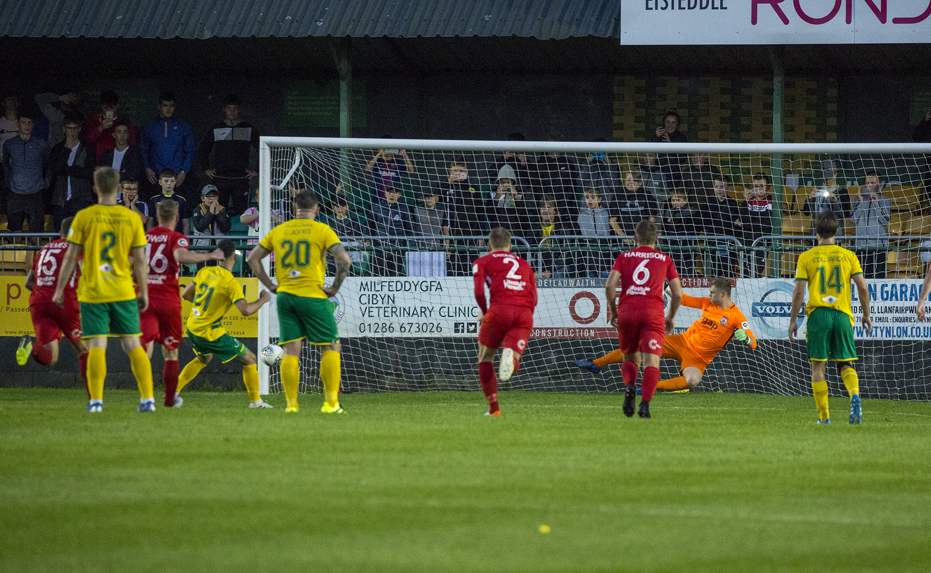 Caernarfon's Leo Smith sees his first half penalty come back off the post | © NCM Media