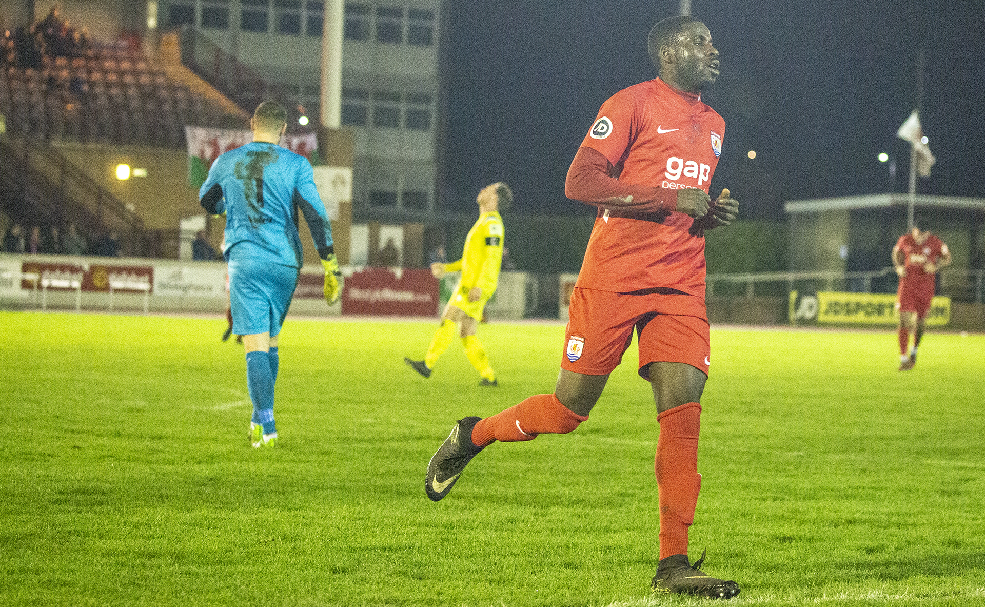 Michael Bakare celebrates The Nomads' third goal of the night | © NCM Media