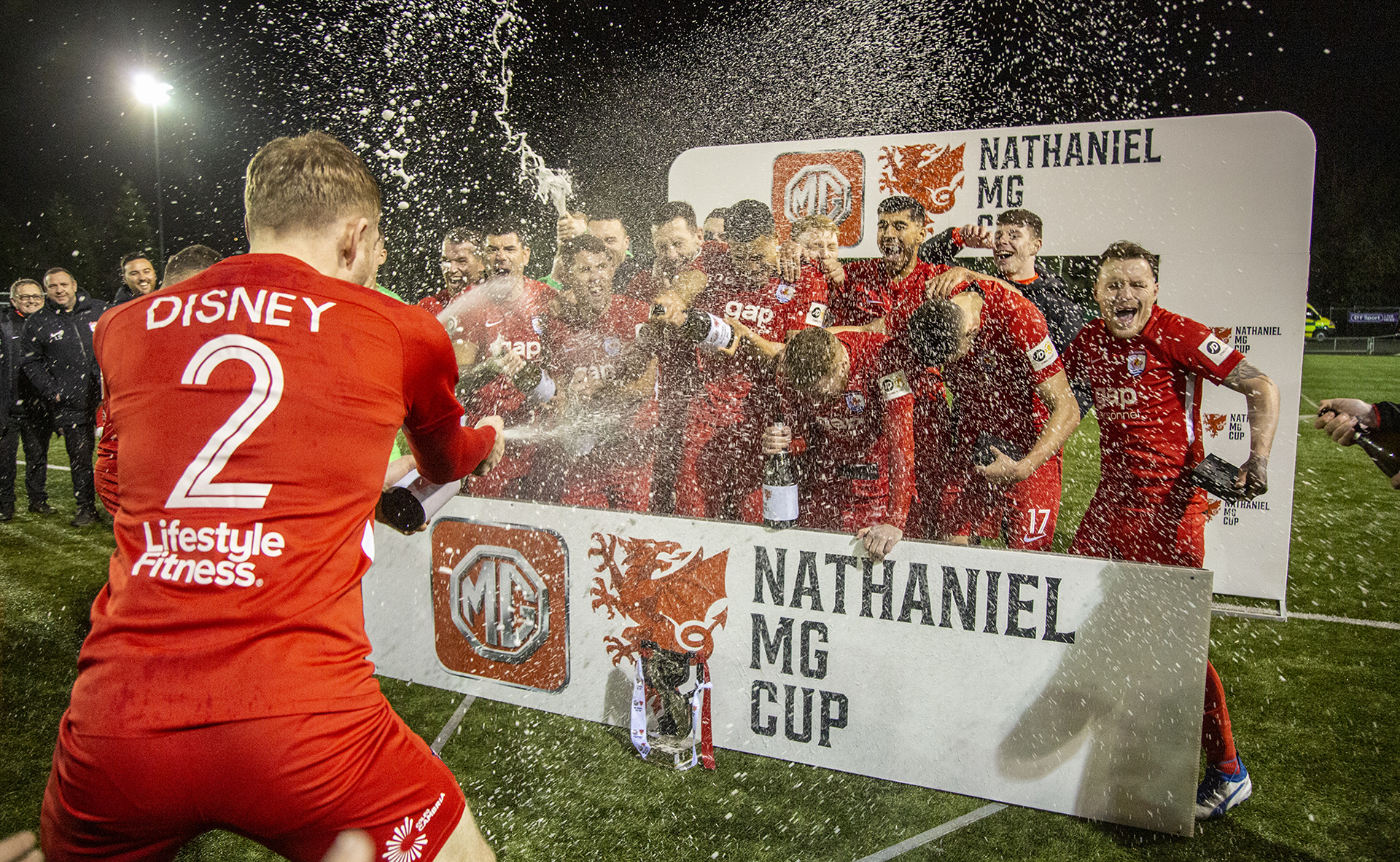 The Nomads' players celebrate with the champagne | © NCM Media