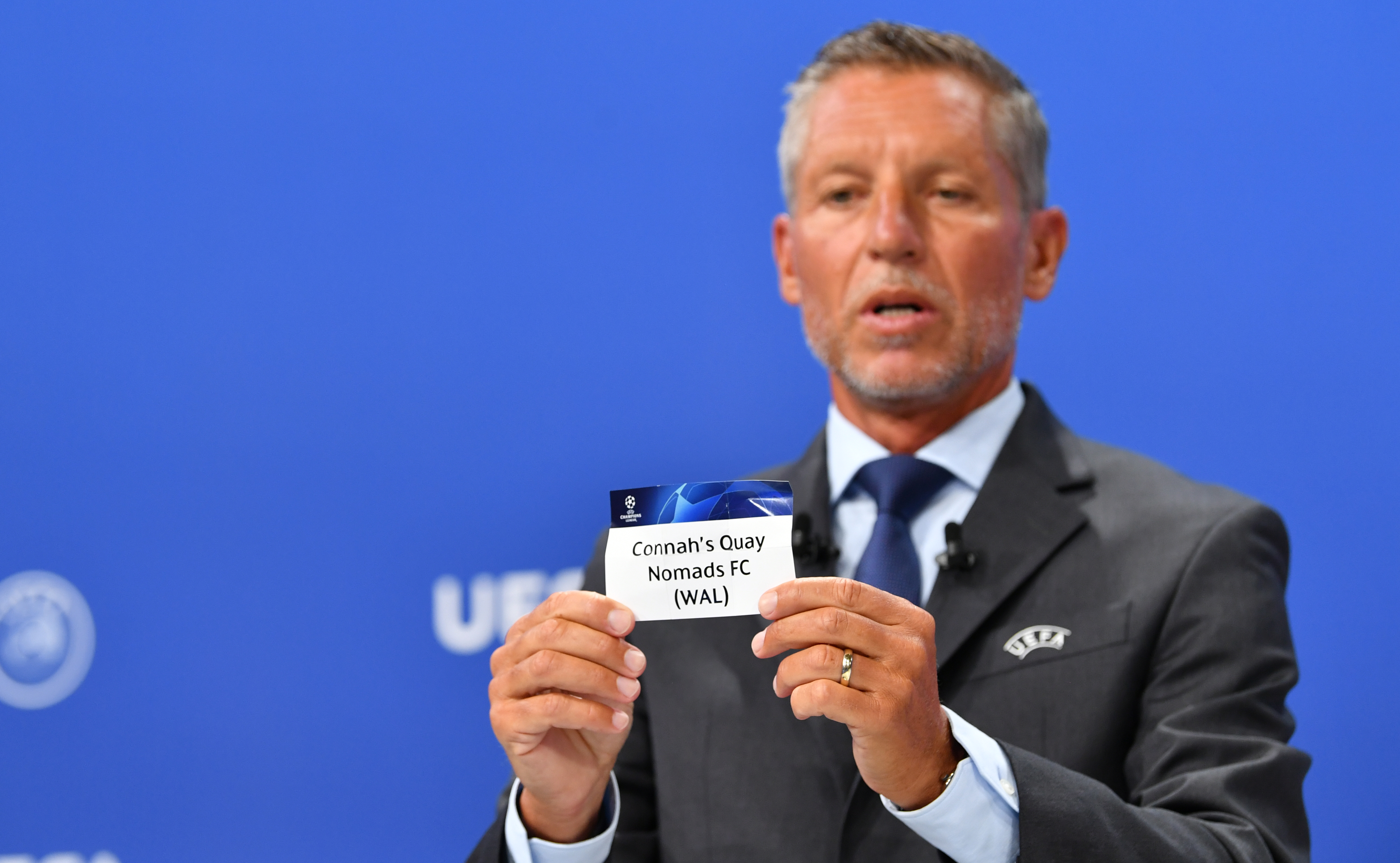 UEFA Head of Club Compeititions Michael Heselschwerdt draw Connah's Quay Nomads out of the pot | © UEFA
